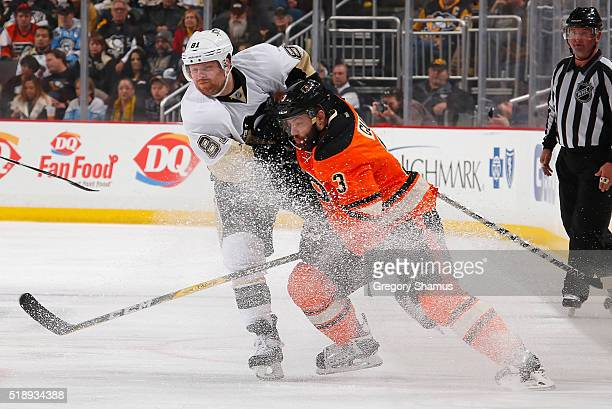 Phil Kessel of the Pittsburgh Penguins and Radko Gudas of the Philadelphia Flyers battle for the loose puck at Consol Energy Center on April 3 2016...