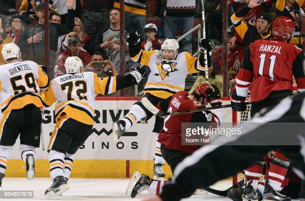Phil Kessel of the Pittsburgh Penguins celebrates as he scores the game tying goal against the Arizona Coyotes as teammates Jake Geuntzel and Patric...