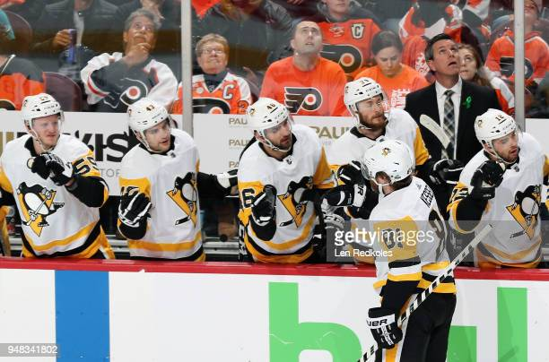 Phil Kessel of the Pittsburgh Penguins celebrates his first period goal against the Philadelphia Flyers with his teammates on the bench in Game Four...