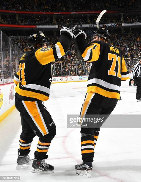 Phil Kessel of the Pittsburgh Penguins celebrates his third period goal against the Buffalo Sabres at PPG Paints Arena on December 2 2017 in...