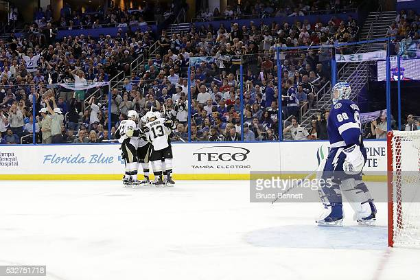 Phil Kessel of the Pittsburgh Penguins celebrates with his teammates after scoring a goal against Andrei Vasilevskiy of the Tampa Bay Lightning...