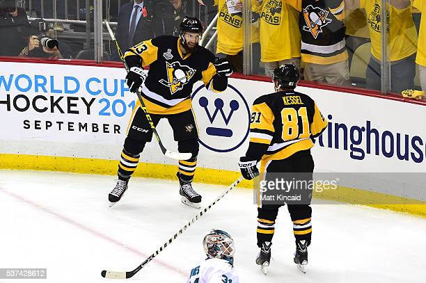 Phil Kessel of the Pittsburgh Penguins celebrates with Nick Bonino after scoring a second period goal against Martin Jones of the San Jose Sharks in...
