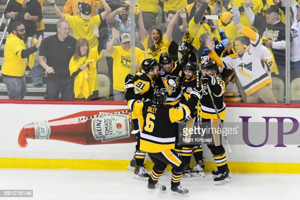 Phil Kessel of the Pittsburgh Penguins celebrates with teammates after scoring a goal during the third period in Game Two of the 2017 NHL Stanley Cup...