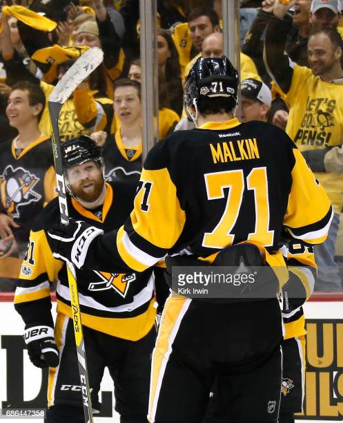 Phil Kessel of the Pittsburgh Penguins celebrates with teammates Evgeni Malkin and Sidney Crosby after scoring a goal against Mike Condon of the...