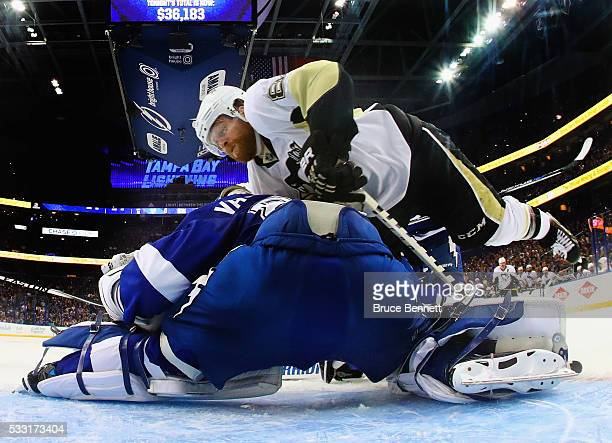 Phil Kessel of the Pittsburgh Penguins flies into Andrei Vasilevskiy of the Tampa Bay Lightning in Game Four of the Eastern Conference Final during...