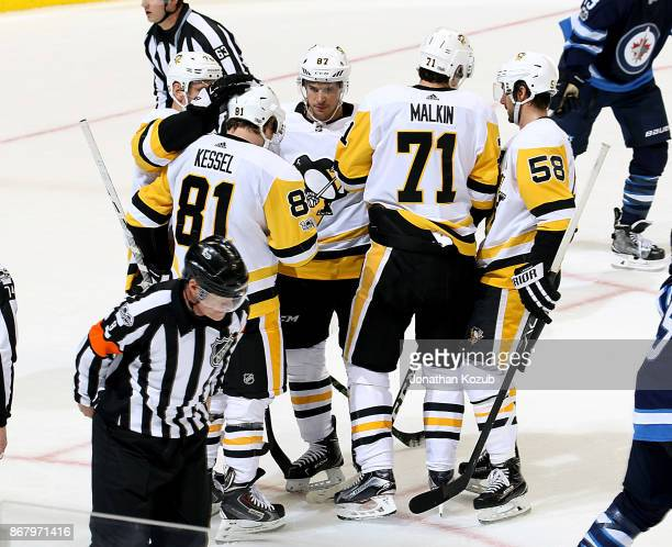 Phil Kessel of the Pittsburgh Penguins gets congratulated by teammates Patric Hornqvist Sidney Crosby Evgeni Malkin and Kris Letang after scoring a...