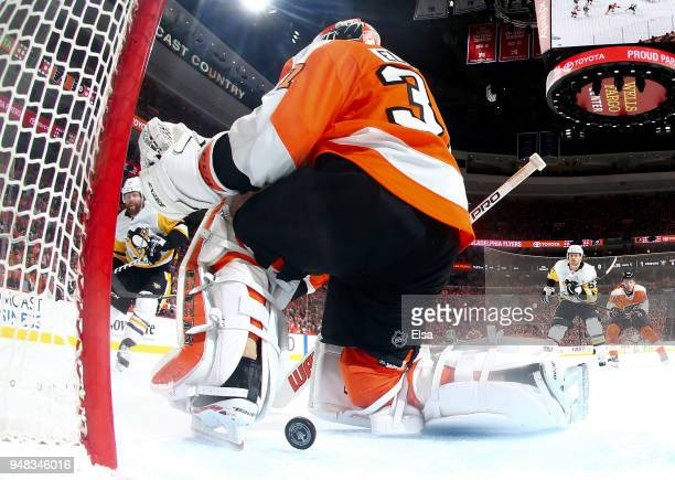Phil Kessel of the Pittsburgh Penguins gets his shot past Brian Elliott of the Philadelphia Flyers in the first period in Game Four of the Eastern...