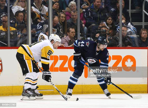 Phil Kessel of the Pittsburgh Penguins gets set during a second period faceoff against Josh Morrissey of the Winnipeg Jets at the MTS Centre on March...