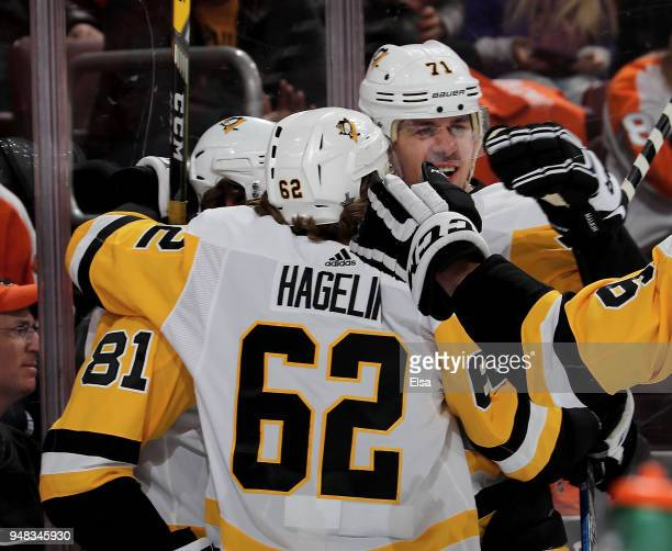 Phil Kessel of the Pittsburgh Penguins is congratulated by teammates Carl Hagelin and Evgeni Malkin after Kessel scored in the first period against...