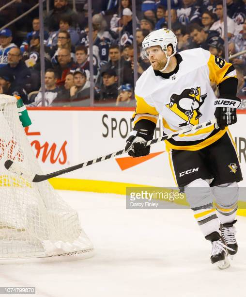 Phil Kessel of the Pittsburgh Penguins keeps an eye on the play during first period action against the Winnipeg Jets at the Bell MTS Place on...