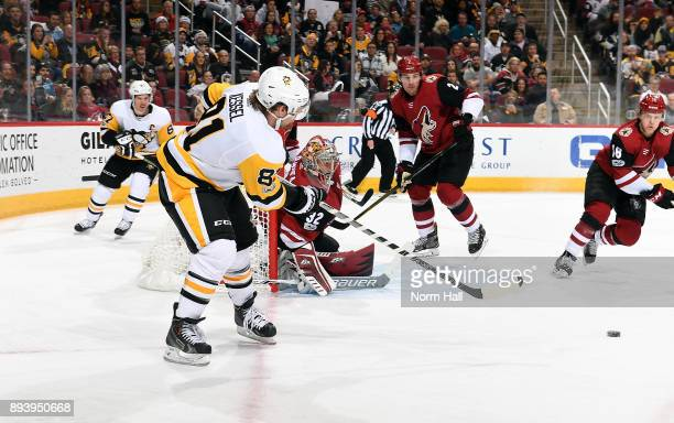 Phil Kessel of the Pittsburgh Penguins passes the puck to the front of the net against the Arizona Coyotes during the first period at Gila River...