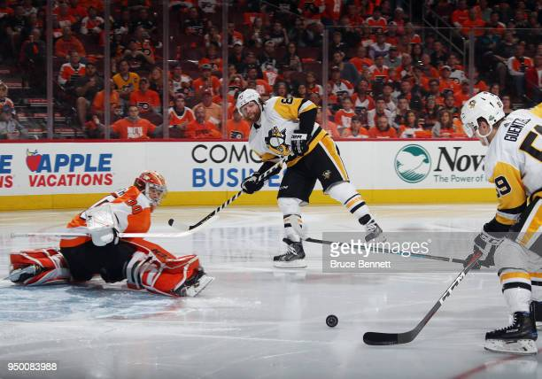 Phil Kessel of the Pittsburgh Penguins passes to Jake Guentzel for a third period goal against Michal Neuvirth of the Philadelphia Flyers in Game Six...