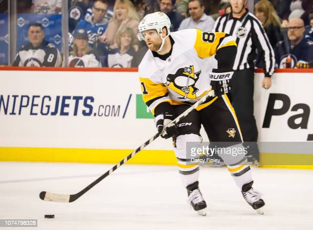 Phil Kessel of the Pittsburgh Penguins plays the puck down the ice during first period action against the Winnipeg Jets at the Bell MTS Place on...