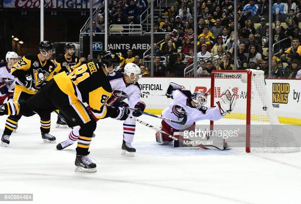 Phil Kessel of the Pittsburgh Penguins puts the game winning goal past Sergei Bobrovsky of the Columbus Blue Jackets at PPG PAINTS Arena on February...