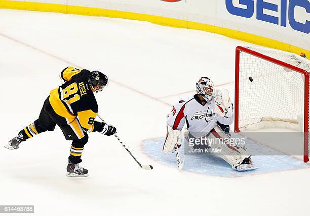 Phil Kessel of the Pittsburgh Penguins scores during the shootout against Braden Holtby of the Washington Capitals at PPG Paints Arena on October 13...