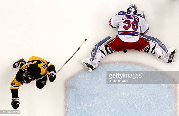 Phil Kessel of the Pittsburgh Penguins scores past Henrik Lundqvist of the New York Rangers in the second period in Game Two of the Eastern...