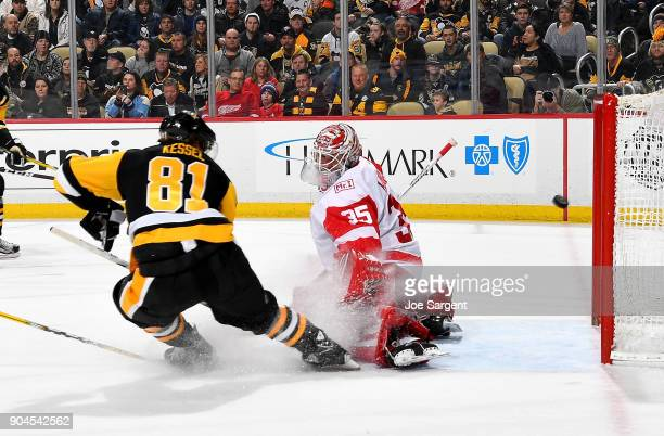 Phil Kessel of the Pittsburgh Penguins scores past Jimmy Howard of the Detroit Red Wings in the first period at PPG Paints Arena on January 13 2018...