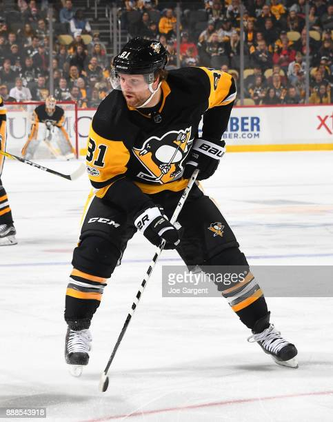 Phil Kessel of the Pittsburgh Penguins skates against the Buffalo Sabres at PPG Paints Arena on December 2 2017 in Pittsburgh Pennsylvania