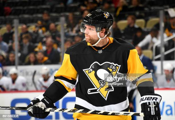 Phil Kessel of the Pittsburgh Penguins skates against the New York Islanders at PPG Paints Arena on December 7 2017 in Pittsburgh Pennsylvania