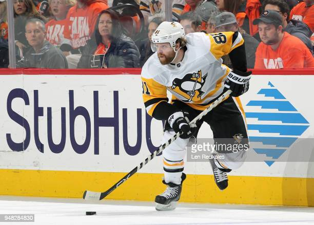 Phil Kessel of the Pittsburgh Penguins skates the puck against the Philadelphia Flyers in Game Three of the Eastern Conference First Round during the...