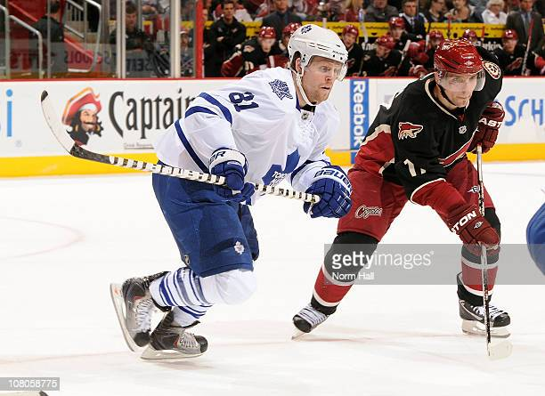Phil Kessel of the Toronto Maple Leafs and Radim Vrbata of the Phoenix Coyotes skate to the puck after a face off on January 13 2011 at Jobingcom...