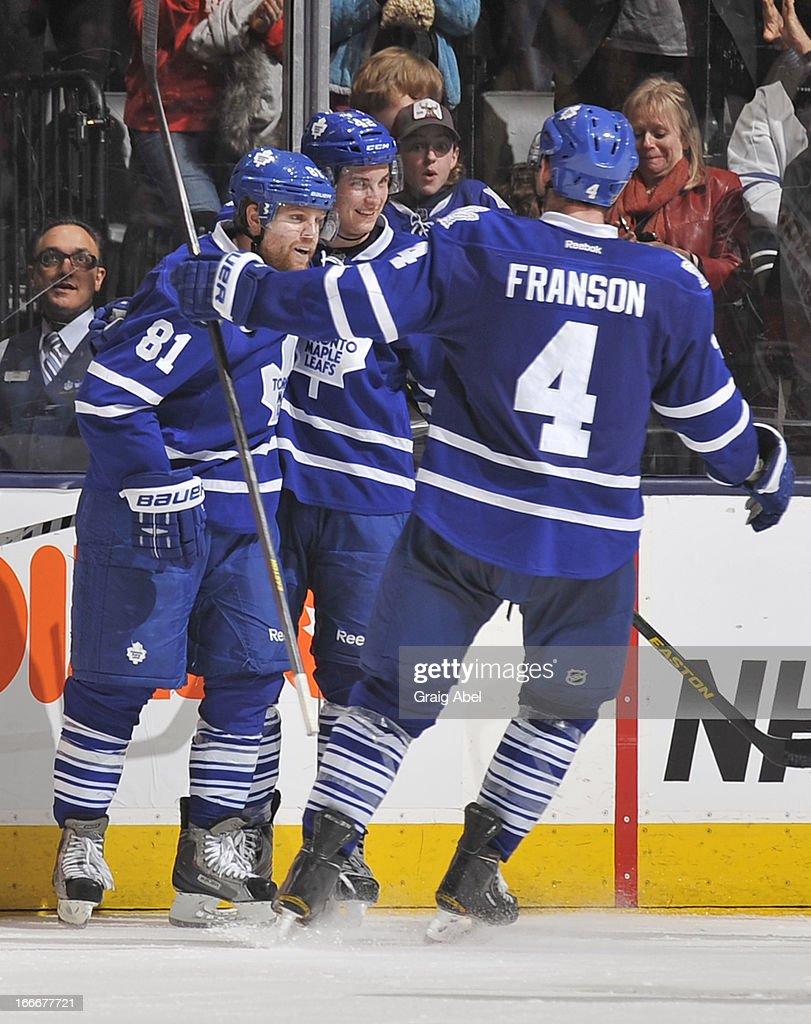 Phil Kessel #81 of the Toronto Maple Leafs celebrates a third period goal with teammates Tyler Bozak #42 and Cody Franson #4 during NHL game action against the New Jersey Devils April 15, 2013 at the Air Canada Centre in Toronto, Ontario, Canada.