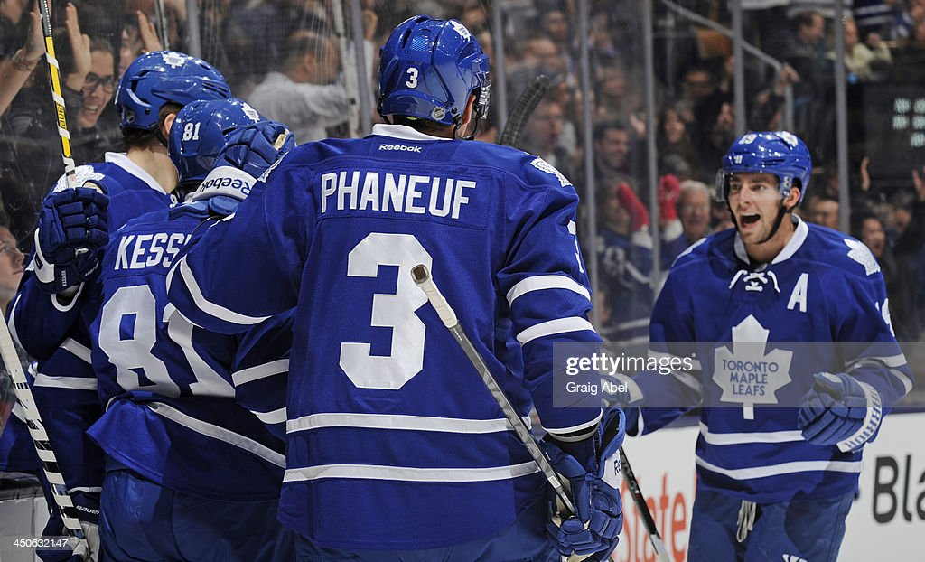 Phil Kessel #81 of the Toronto Maple Leafs celebrates his second period goal with teammates during NHL game action against the New York Islanders November 19, 2013 at the Air Canada Centre in Toronto, Ontario, Canada.