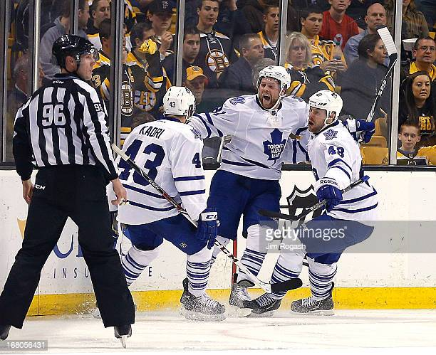 Phil Kessel of the Toronto Maple Leafs celebrates with teammates Nazem Kadri and Ryan Hamilton after scoring a goal in the third period against the...