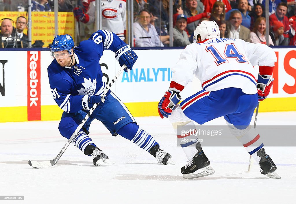 Phil Kessel #81 of the Toronto Maple Leafs gets around Tomas Plekanec #14 of the Montreal Canadiens during NHL action at the Air Canada Centre April 11, 2015 in Toronto, Ontario, Canada.