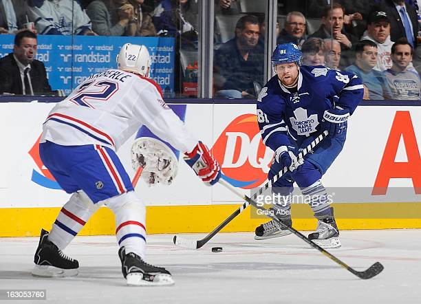 Phil Kessel of the Toronto Maple Leafs looks to pass the puck as Tomas Kaberle of the Montreal Canadiens defends during NHL game action February 27...