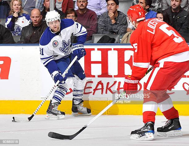 Phil Kessel of the Toronto Maple Leafs looks to pass the puck as Nicklas Lidstrom of the Detroit Red Wings defends during game action November 7 2009...