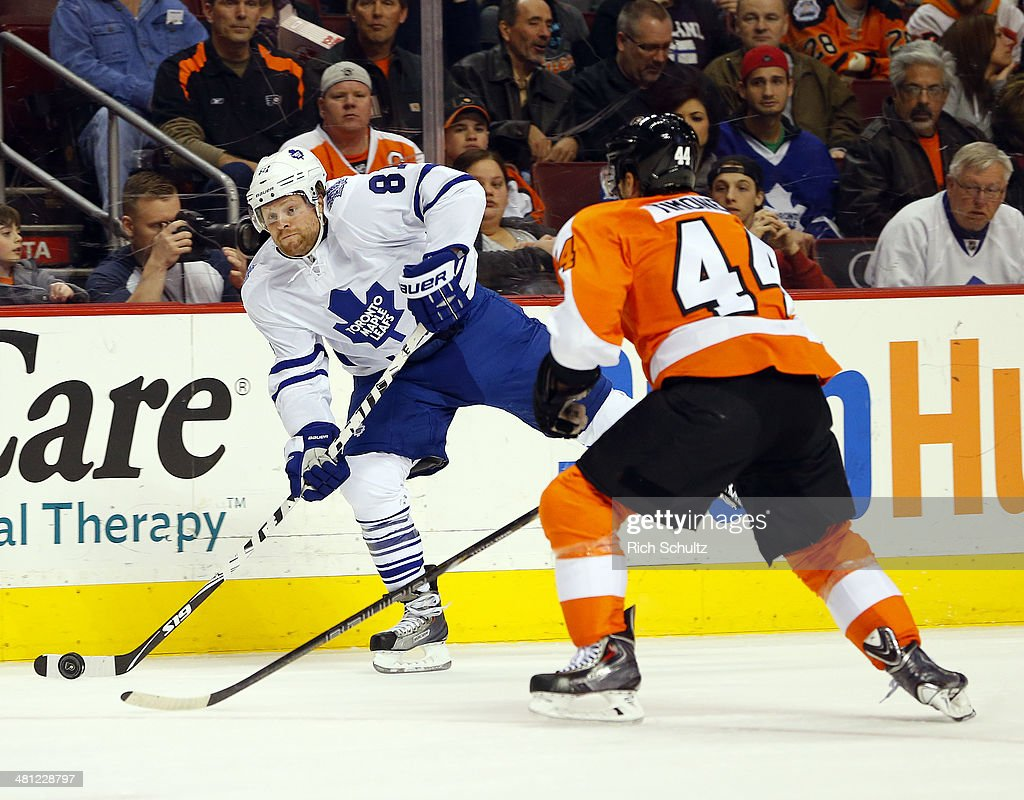 Phil Kessel #81 of the Toronto Maple Leafs takes a shot as Kimmo Timonen #44 of the Philadelphia Flyers defends during the first period at Wells Fargo Center on March 28, 2014 in Philadelphia, Pennsylvania. The Flyers defeated the Maple Leafs 4-2.