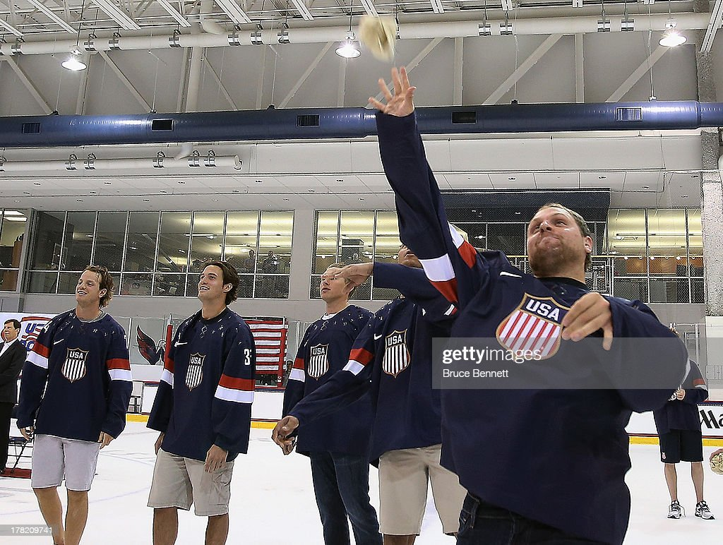 Phil Kessel of the Toronto Maple Leafs throws a tshirt to fans following a press conference introducing the 2014 USA Hockey Olympic Team candidates at the Kettler Capitals Iceplex on August 27, 2013 in Arlington, Virginia.