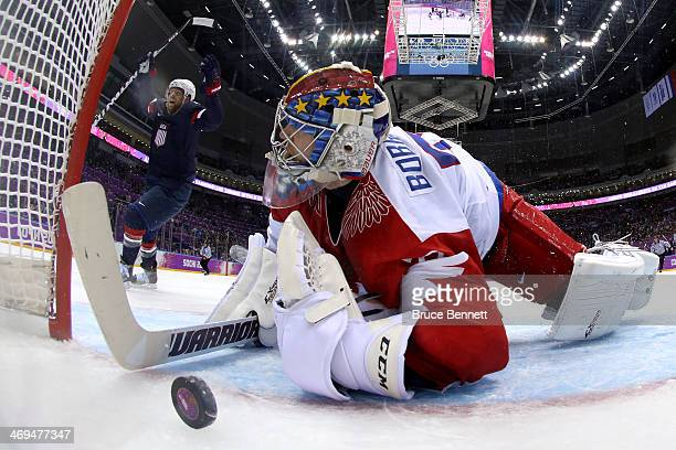 Phil Kessel of the United States celebrates after teammate Cam Fowler scored a goal on Sergei Bobrovski of Russia in the second period during the...