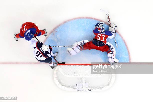 Phil Kessel of the United States scores a goal in the third period against Alexander Salak of the Czech Republic during the Men's Ice Hockey...