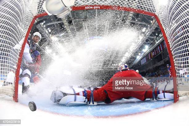 Phil Kessel of the United States scores his team's fifth goal past Alexander Salak of the Czech Republic in the third period during the Men's Ice...