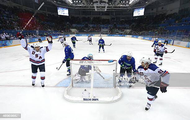 Phil Kessel of the United States scores his third goal against Luka Gracnar of Slovenia in the second period as James van Riemsdyk celebrates during...
