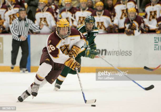 Phil Kessel of the University of Minnesota Golden Gophers skates with the puck against the University of Alaska Anchorage Seawolves during the WCHA...