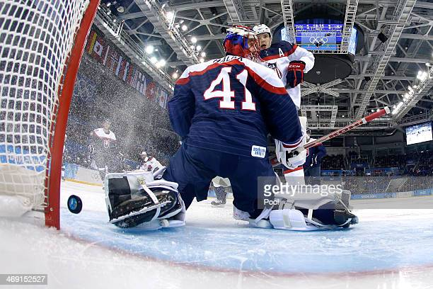 Phil Kessel of United States scores a goal against Jaroslav Halak of Slovakia in the second period during the Men's Ice Hockey Preliminary Round...