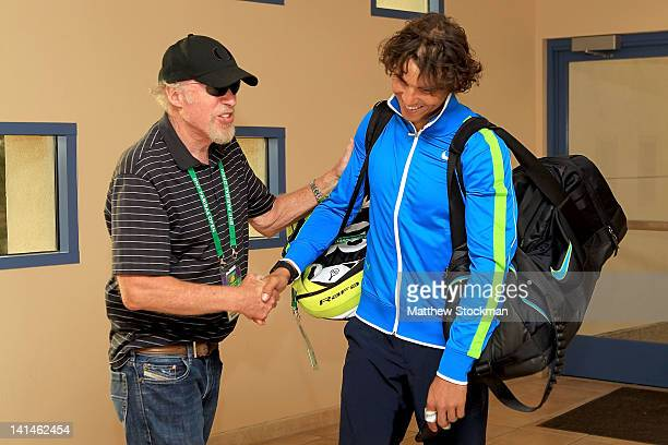 Phil Knight founder and chairman of Nike congratulates Rafael Nadal of Spain after his win over David Nalbandian of Argentina during the BNP Paribas...