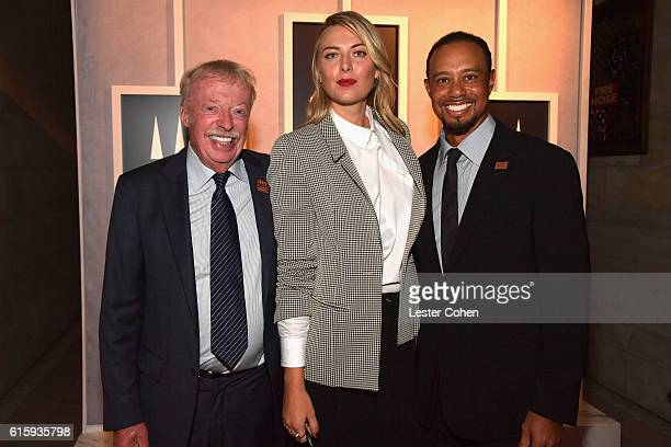 Phil Knight Maria Sharapova and Tiger Woods attend the Tiger Woods Foundation's 20th Anniversary Celebration at the New York Public Library on...