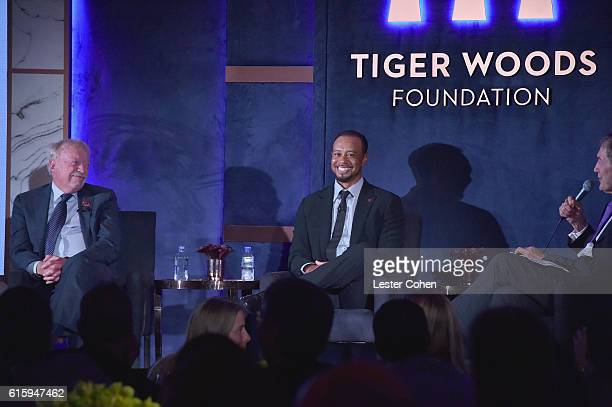 Phil Knight Tiger Woods and Charlie Rose speak onstage during Tiger Woods Foundation's 20th Anniversary Celebration at the New York Public Library on...
