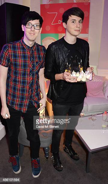 Phil Lester and Dan Howell attend YouTube phenomenon Zoe Sugg's launch of her debut beauty collection at 41 Portland Place on September 25 2014 in...