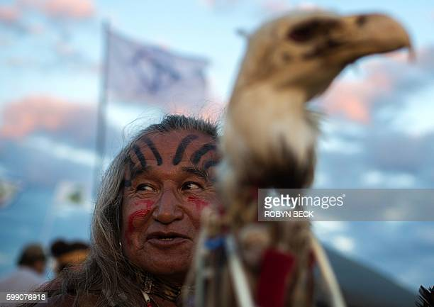 Phil Little Thunder Sr attends an evening gathering at an encampment where hundreds of people have gathered to join the Standing Rock Sioux Tribe's...