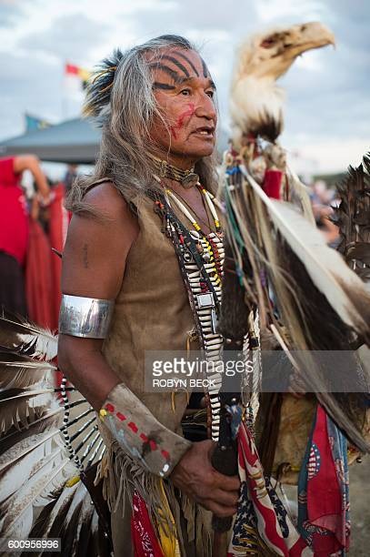 Phil Little Thunder Sr is dressed in ceremonial dance garb at a protest encampment near Cannon Ball North Dakota where members of the tribe and their...