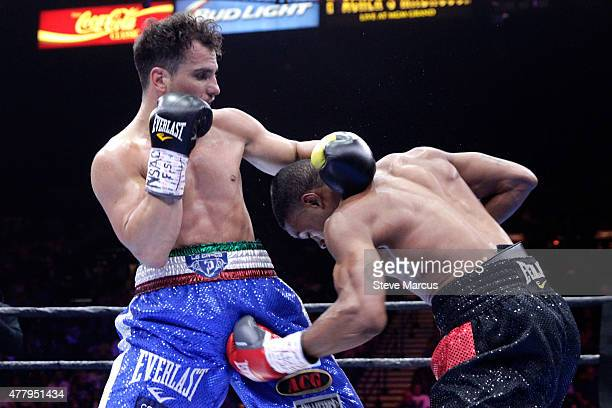Phil Lo Greco is hit by a low blow from Errol Spence Jr during their welterweight fight at MGM Grand Garden Arena on June 20 2015 in Las Vegas Nevada...