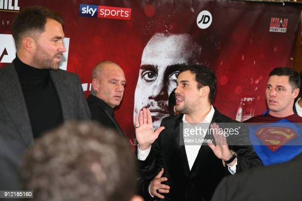 Phil Lo Greco speaks with Eddie Hearn during an Amir Khan and Phil Lo Greco press conference at the Hilton Hotel on January 30 2018 in Liverpool...
