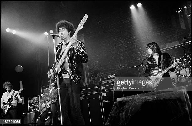 Phil Lynott and Scott Gorham of Thin Lizzy and the band's original guitarist Eric Bell rehearse with Snowy Whit and Darren Wharton during a...