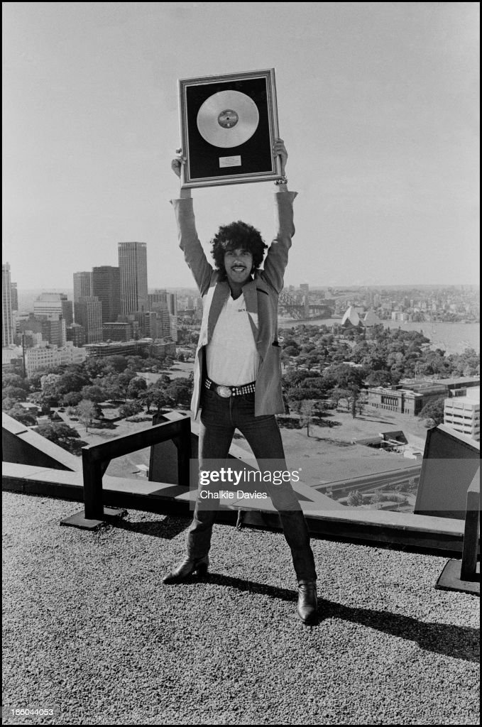 Phil Lynott from Thin Lizzy holds a gold disc above his head in Sydney, Australia in 1978.