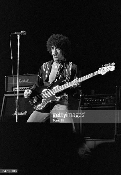 Phil Lynott of Thin Lizzy performing onstage at Omni Coliseum